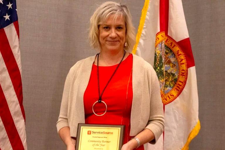 Woman receiving Service Excellence Award in Florida