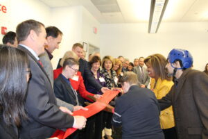 group cutting ribbon