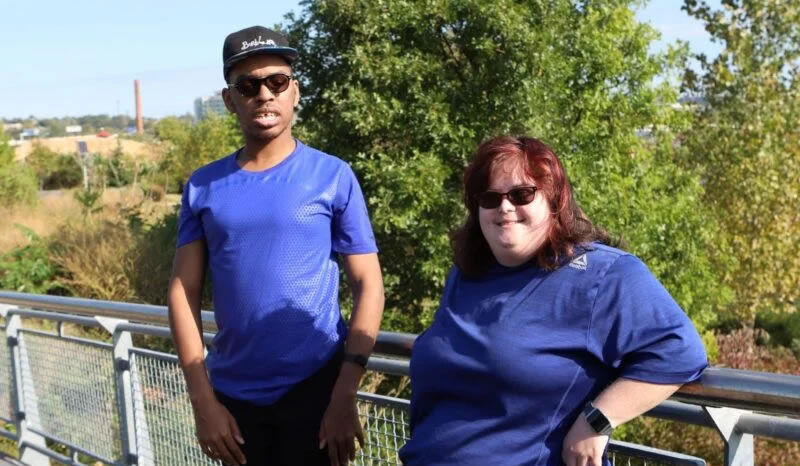 two adults participating in outdoor exploration of Delaware's Riverfront Community Center