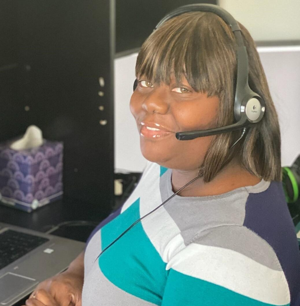 woman with headset smiling at camera