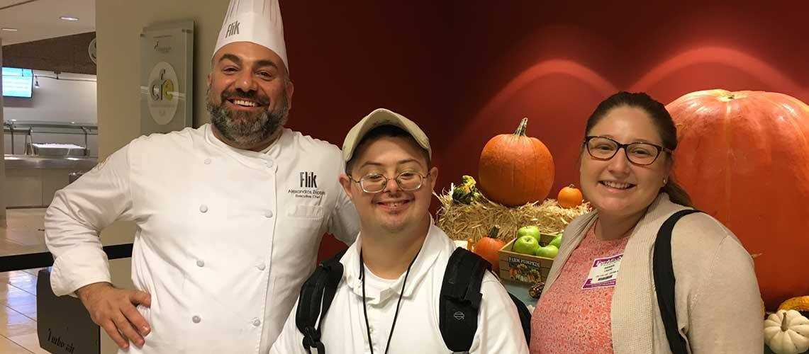 Sam Selnick, pictured center, with supervisor from Flik Catering