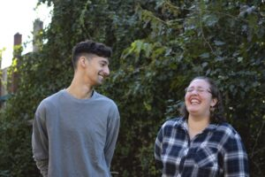 Two people laughing together